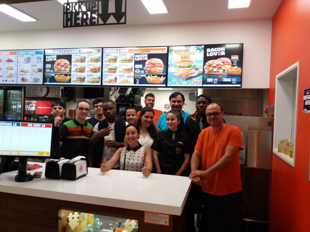 Burger King Restaurant Employees in Renens smiling after training by Nieco